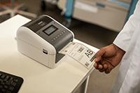 Doctor printing medical label using Brother TD-4550DNWB desktop label printer