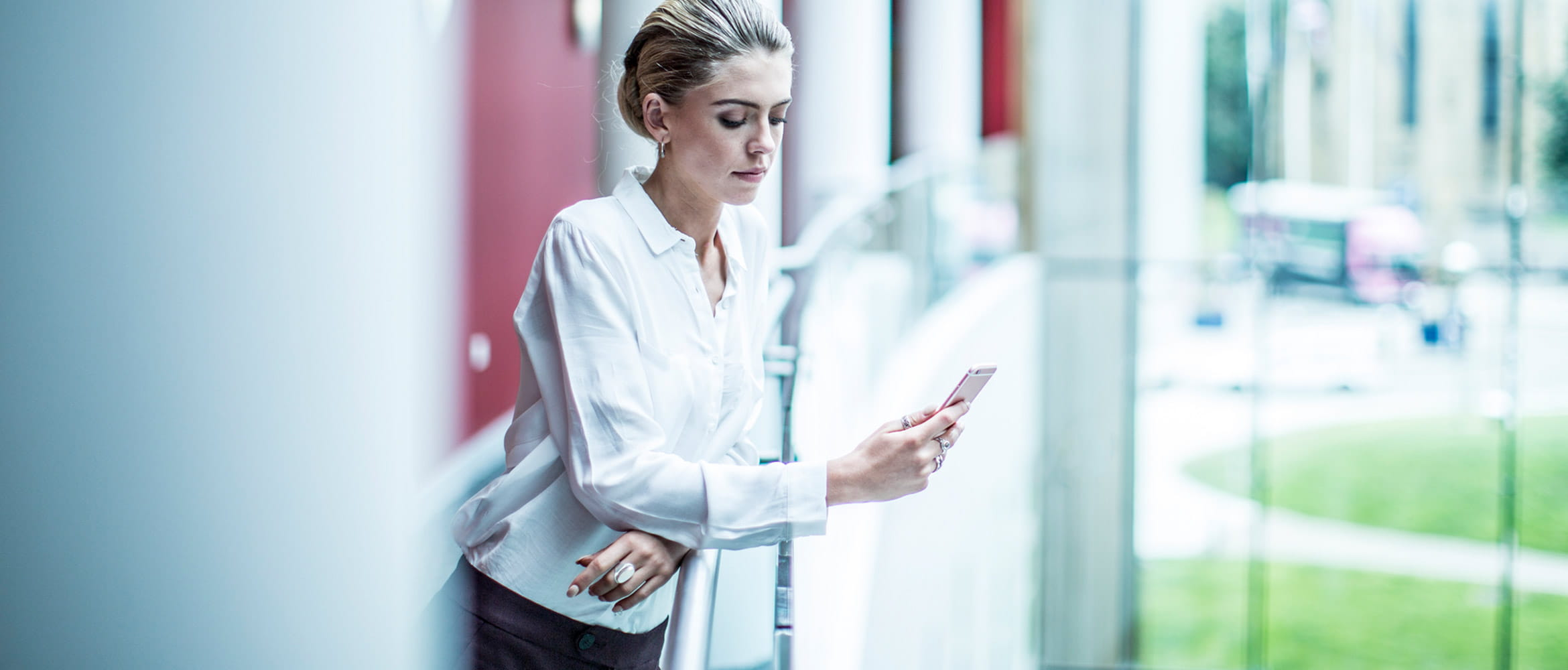 Professionally dressed lady using Brother support center app on her mobile