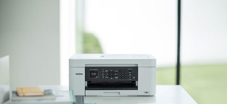 Brother MFC-J497DW inkjet printer on desk in home office