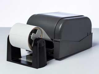 Option roll holder installed on a Brother TD-4D label printer